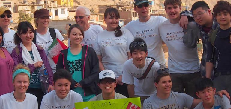 Students and Teachers build foundations in Peru